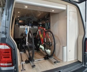 Two road bikes in the rear of a triathlon camper conversion